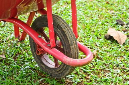summergarden: Red wheelbarrow in a garden Stock Photo