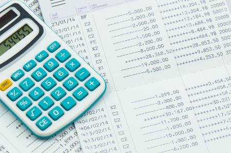 close up bank statement with calculator