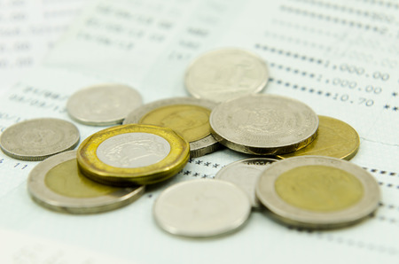 bank statement: Coins on bank statement Stock Photo