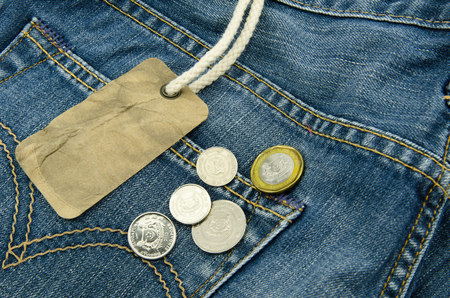 Blue jean with blank price tag and coins  photo