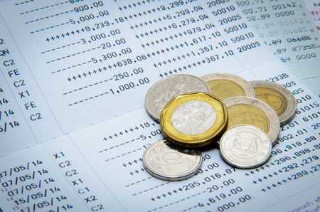 bank statement: Money coins and bank statement