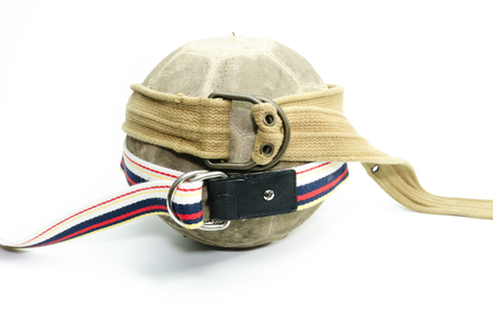old ball with fabric belt isolate on white background Stock Photo
