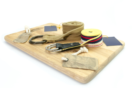 set of fabric belt and label on wood background photo