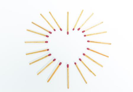 consumable: heart shape matches on white background  Stock Photo