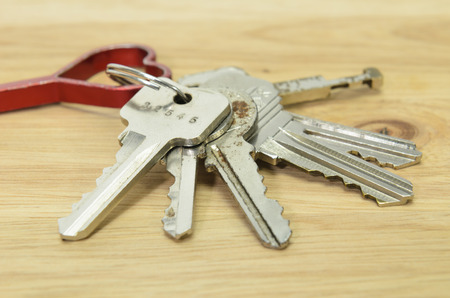 tresspass: keychain on wood background  Stock Photo