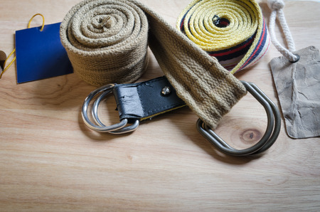 set of fabric belt and label on wood background photo