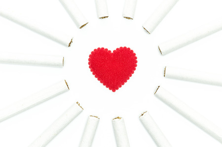 cigarettes around red heart design for ideas and conceptual