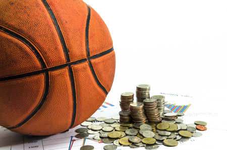 basketball and money coins on white background