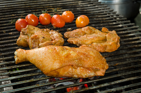 A leg chicken and meat are grilling on grill Stock Photo