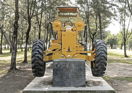 The tractor is parking in a park.