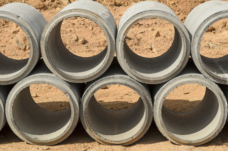 sewer water: The concrete drainage pipes are in construction area Stock Photo