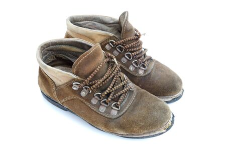 hillwalking: The old work boot is on white background. Stock Photo