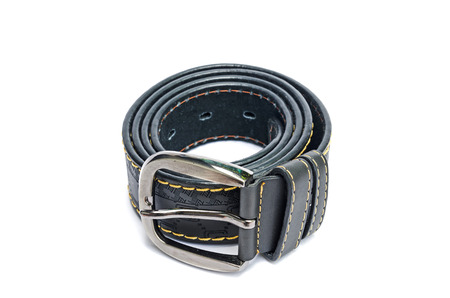 A leather belt is on white background. Stock Photo