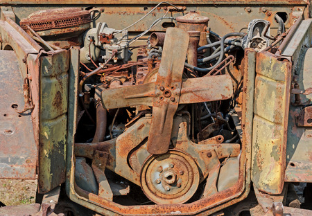 horse pipes: The old rusty engine is in the old car. Stock Photo