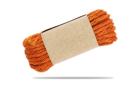 The orange hemp rope is on white background. Stock Photo