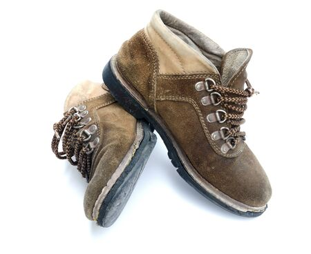 The old work boot is on white background. Stock Photo