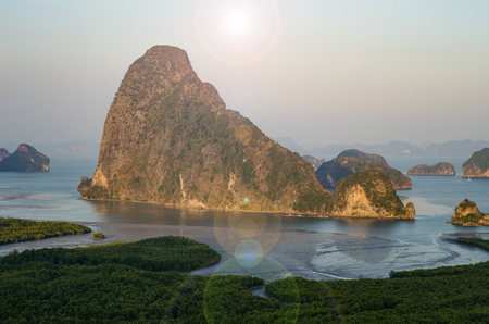 Lens flare mountain in the water Stock Photo
