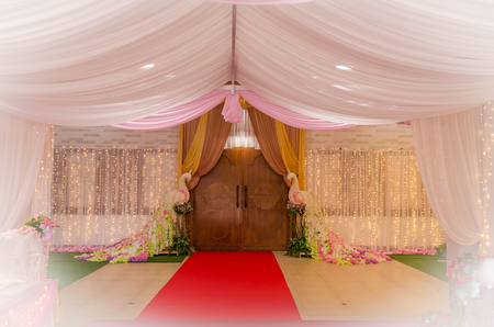 wedding ceremony entrance decoration with flower and peacook flower