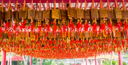 a lot of chinese pray tag are in a chinese temple at Suphanburi provinc, Thailand