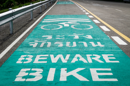 bike lane symbol share with street car in a park  Stock Photo