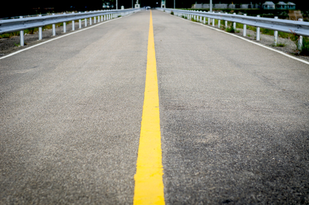 open road to mountain with nature on dam at Phuket, Thailand