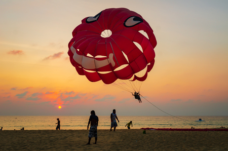 red parasailing extrem sport on beach sunset, Phuket, Thailand on 17 February 2018 Foto de archivo
