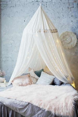 cozy bedroom with canopy Archivio Fotografico