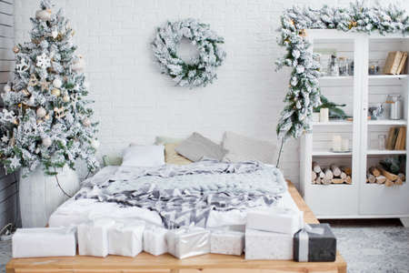 white bedroom with Christmas decorations Reklamní fotografie