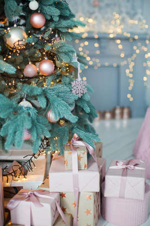 Christmas tree with pink and gold decorations Stock Photo