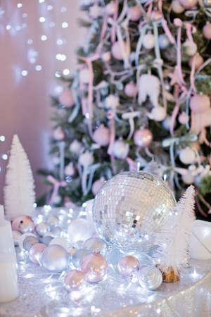 christmas background with candles, silver balls, blue garland and disco ball