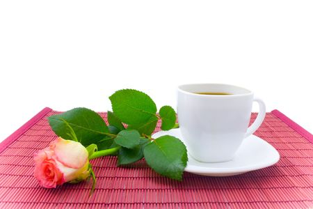White cup of coffee and rose