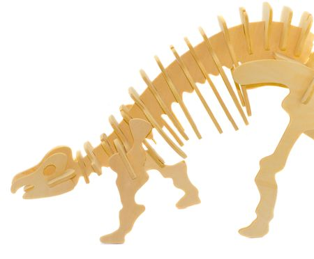 Element of wooden model of a dinosaur - children toy photo