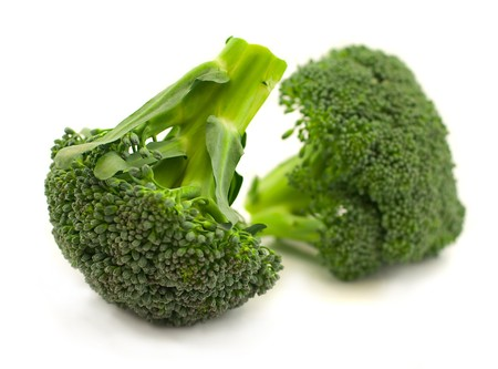 Two branches of cabbage of a broccoli on � white background