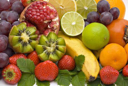 Bananas, kiwi grapes, pear, oranges, tangerines, lemons and strawberry photo