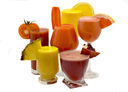 Five glasses of fresh juice from different fruit
