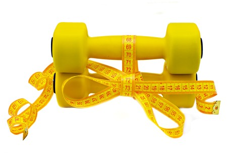 Dumbbell and a centimetric tape on a white background photo