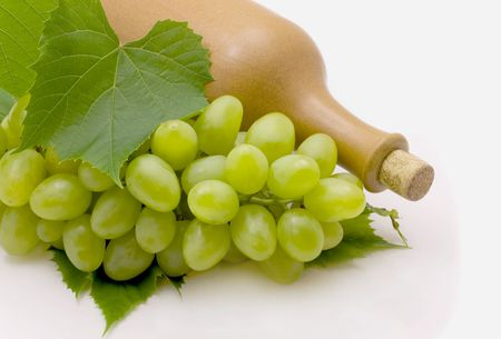 drink food: wine and green grapes isolated on white background