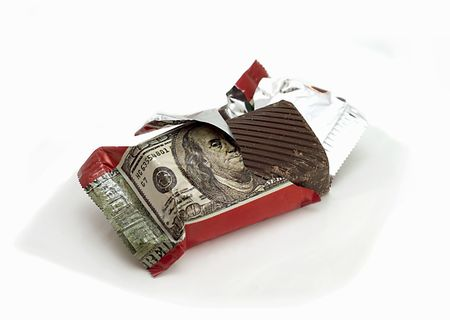 Chocolate with the image of a dollar banknote on a candy wrapper