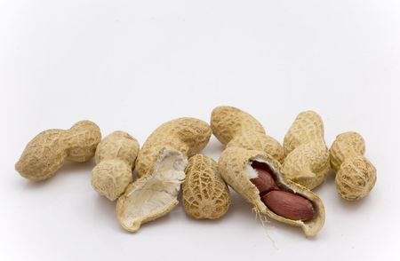 Some peanuts - are isolated on white background photo