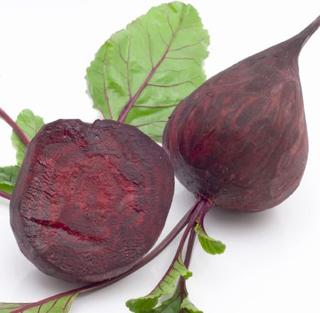 Two beet with  leaves isolated on  white background Imagens