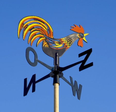 blustery: Weather vane against the blue sky Stock Photo
