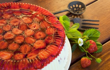 Strawberry pie, branch strawberry, leaves on wooden table photo