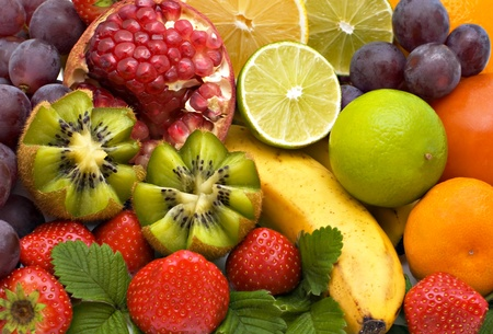 Bananas, kiwi grapes, pear, oranges, tangerines, lemons and strawberry