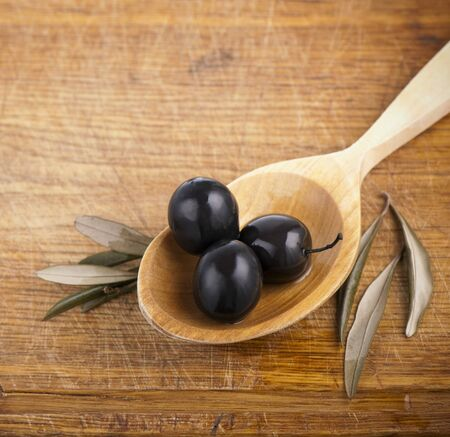 Olives on  spoon photo