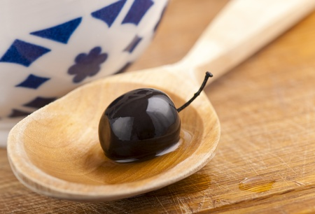 Wooden spoon,  olives photo