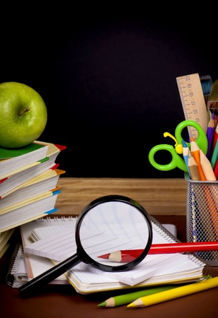 Stack of books,  apple, globe and pencils Stock Photo - 13539104