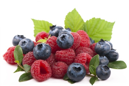 Raspberries and blueberries on white background Imagens