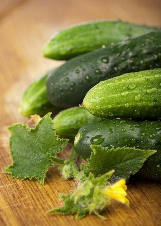 ehec: Green fresh cucumbers on a wooden decks Stock Photo