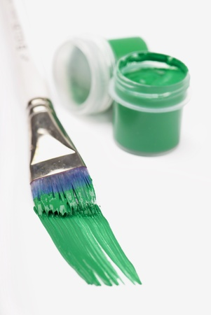 banks and brush with green paint on a white background Stock Photo - 17314427