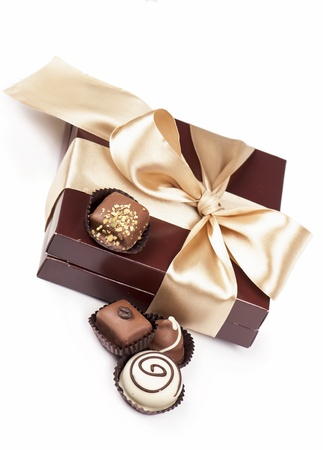 brown box with candies and golden tape photo